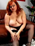 Hot stockinged fatty exposes her huge knockers
