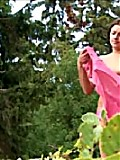 Teen babe empties her bladder under the boughs