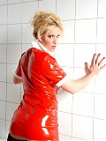 Blonde in red latex and nylons