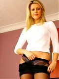 Morgan M is dressed in her secretary outfit; a tight top miniskirt and pantyhose