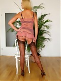 Blonde milf in hottest lingerie , 50`s high heels and seamed nylons