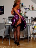 Sexy babe stripping in pink mini cocktail dress and black stockings