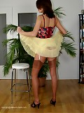 Hot babe stripping corsage and mini skirt in suntan rht nylons