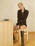 Sheer Nude Pantyhose And Knee High Boots At The Desk