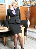 Business Woman Lucy Zara In A Business Suit And Black Fishnet Stockings