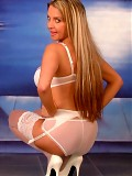 Wendi in white stockings and heels show her blond long hair