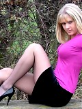 Lucina outdoors in black nylons and heels