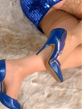 Chrissy show her blue pumps and tan stockings