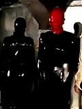Severe mistress and latex and her assistant keep rubber dolls under brief control
