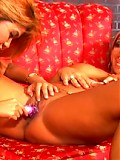 Two sexy lesbos play with toys and lick nipples before hard strapon fucking