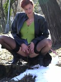 Horny redhead in stockings caught peeing in the park