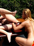 Horny sun kissed lesbian gets her pussy split with a fist