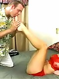 Catalina jerks off a white monster size penis through her feet