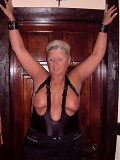 Granny in rubber peephole bra takes on two guys at once