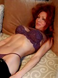 Redheaded milf with nice rack takes some cock in her wet pussy