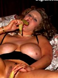 Big girl Carly enjoys a banana and dick