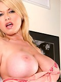 Carolyn Monroe gives a younger guy a great titty fuck