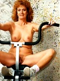 Old redhead works out nude