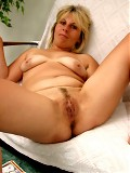 A Czech housewife strips and spreads her pussy