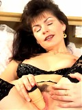 Hot mom plays with her new dildo