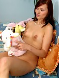 Sweet teen brunette with her toys