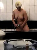 Busty mature woman caught taking a shower