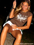 Taylor enjoys herself on the swing but...oh oh! - she doesn't wear any panties!...