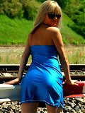 Babe gives legshow at railway crossing