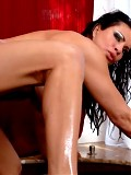 Teri Weigel fucks a young stud in her hot tub