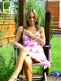 Melanie relaxing in the garden in a sexy summer dress.