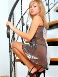 Blonde teen gets naked on the stairs