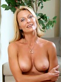 Busty babe Brenda James exposes her ample breasts during her interview with Anilos.com