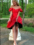 Young Anastasia dressed in a red dress and pantyhose