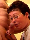 Granny in glasses is getting her holes filled with dick