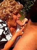 Curly 63 y.o. grandma riding strong cock outdoors