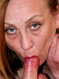 Mature tattooed woman rides a young man's hard on