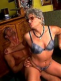 Sexy granny rides her lover in a bar