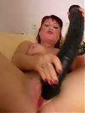 A hot MILF getting off on a big rubber cock