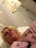 Squirting blonde mature cunt in full action