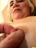 Horny granny playing with her luscious body