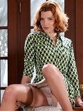 Redhead secretary in dress and holdup stockings