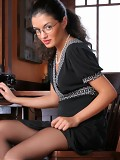 Hot secretary with glasses in black stockings