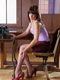 Brunette secretary in black lingerie and stockings