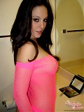 A Peek at Natalies nipples in this pink fishnet dress.