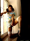 Ponytailed teen in fishnets goes naughty in a window