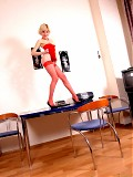 Naughty Hally poses in red clothes and stockings