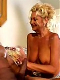 Mature skank swallows black snake.