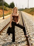 Sexy babe Sophie Moone stripping on a railroad track