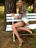 Long legged blonde stripping outdoors in brown seamed nylons