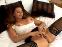 Flirty Megan shows off her clit and plays with a large ..